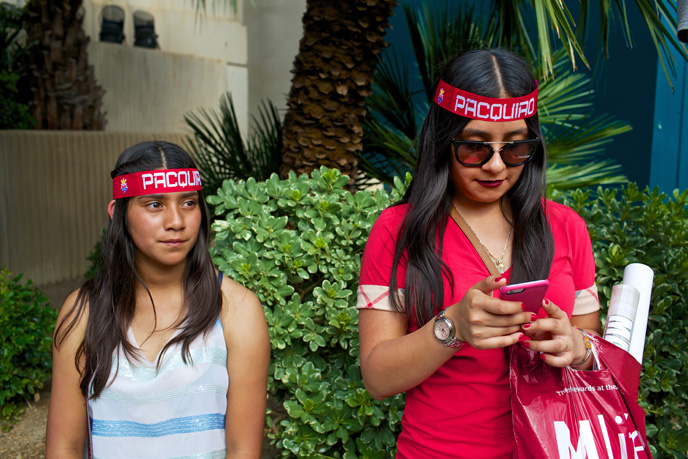 Claudi Ruiz, left, and Karla Silva, of Los Angeles, Calif., pause outside the MGM Grand on the Las Vegas Strip on Saturday, May 2, 2015.